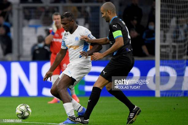 """Former French player Marcel Desailly fights for the ball with French-US former basketball player Tony Parker during the charity """"Heroes"""" football..."""
