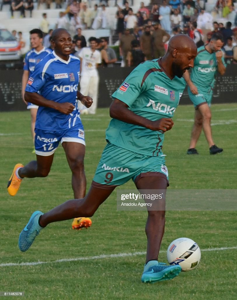 Former French player Nicolas Anelka in action during friendly match with Pakistani football players in Lahore Pakistan on July 9 2017 Eight of...