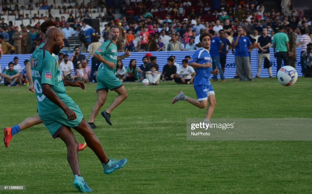 Former French players Nicolas Anelka english player Ryan Giggs play with pakistan football player during friendly matchJuly 9 2017 in Lahore Eight of.