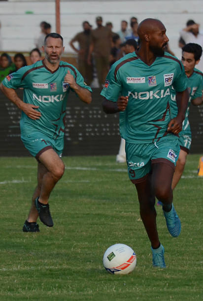 Former French players Nicolas Anelka Former english player Ryan Giggs during friendly match with Pakistani football playersJuly 9 2017 in Lahore...