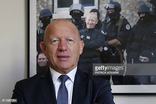 Former French policeman JeanLouis Fiamenghi poses for a photograph on February 17 2016 in Paris Fiamenghi was one of four police officers who shot...