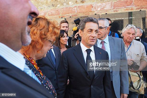 Former French president and candidate for the rightwing Les Republicains party primary ahead of the 2017 presidential election Nicolas Sarkozy walk...