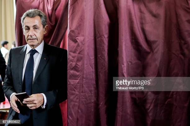 Former French President and former Head of Les Republicains right wing Party Nicolas Sarkozy and his wife the singer Carla Bruni Sarkozy vote in the...