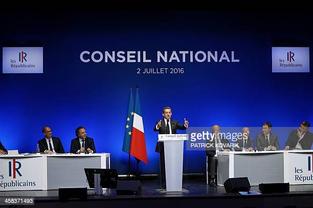 Former French president and head of the rightwing opposition party Les Republicains Nicolas Sarkozy gestures as he delivers a speech on July 2 2016...