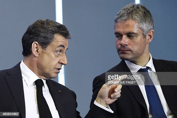 Former French President and head of the UMP rightwing opposition party Nicolas Sarkozy speaks with the Mayor of Le PuyenVelay Laurent Wauquiez a...
