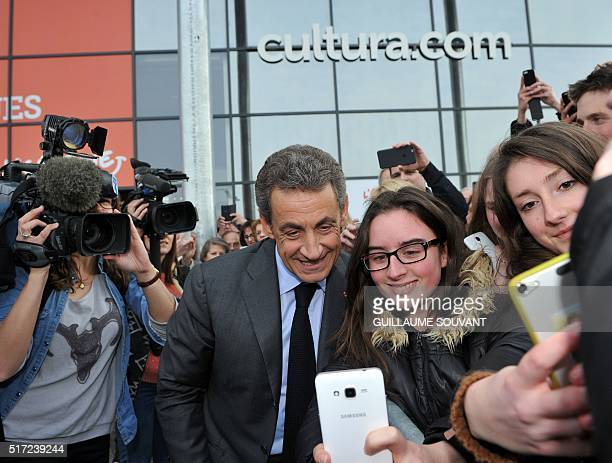 "Former French President and leader of France's Les Republicains party Nicolas Sarkozy poses with supporters as he arrives to sign his book ""La France..."
