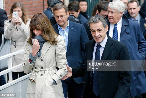 Former French President and presidential candidate hopeful Nicolas Sarkozy and his wife Carla BruniSarkozy arrive to cast their votes during the...