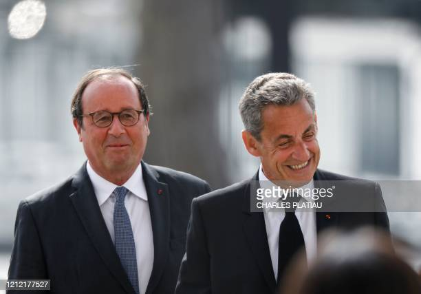 TOPSHOT Former French president Francois Hollande and Former French president Nicolas Sarkozy attend a ceremony to mark the end of World War II at...