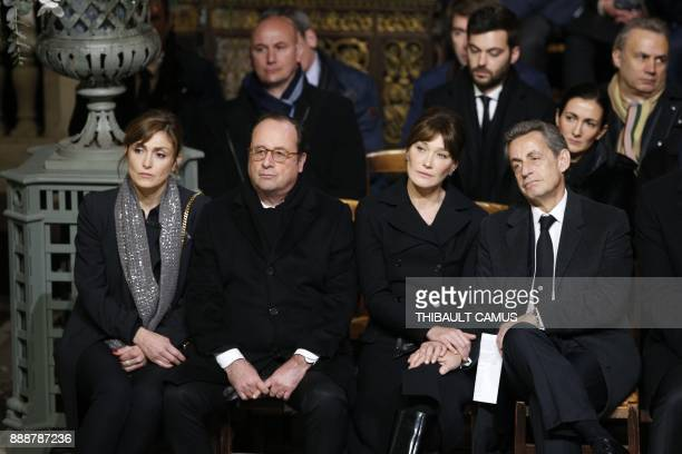 TOPSHOT Former French president Francois Hollande and French actress Julie Gayet sit next to former French president Nicolas Sarkozy and Carla Bruni...
