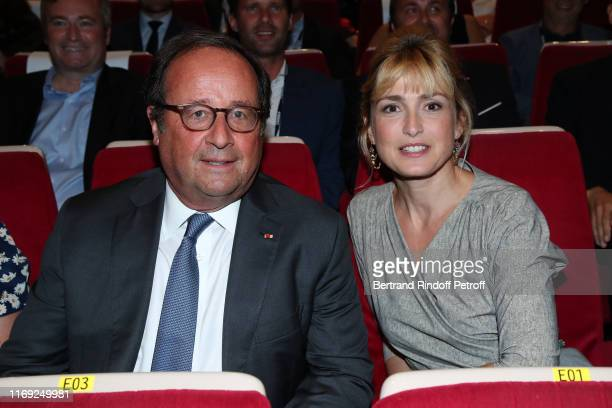 Former French President Francois Hollande and Julie Gayet attend the 12th Angouleme FrenchSpeaking Film Festival Day One Opening Ceremony on August...