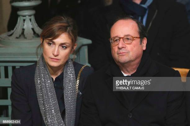 Former French President Francois Hollande and Julie Gayet attend the funeral ceremony for the late French singer Johnny Hallyday at the Eglise de la...
