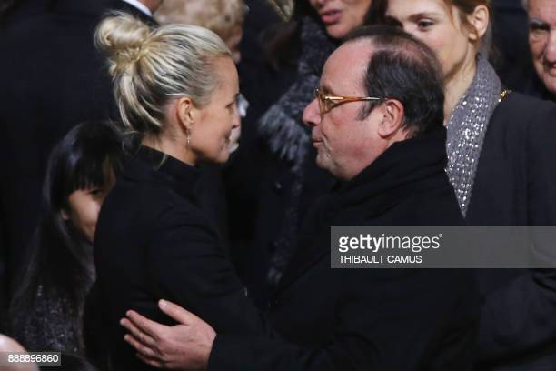 Former French President Francois Hollande gives condolences to Laeticia Hallyday the widow of French musician Johnny Hallyday during the funeral...