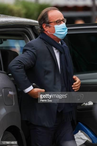 Former French President François Hollande and Julie Gayet attend the Funerals of Singer Juliette Greco on October 05, 2020 in Paris, France.