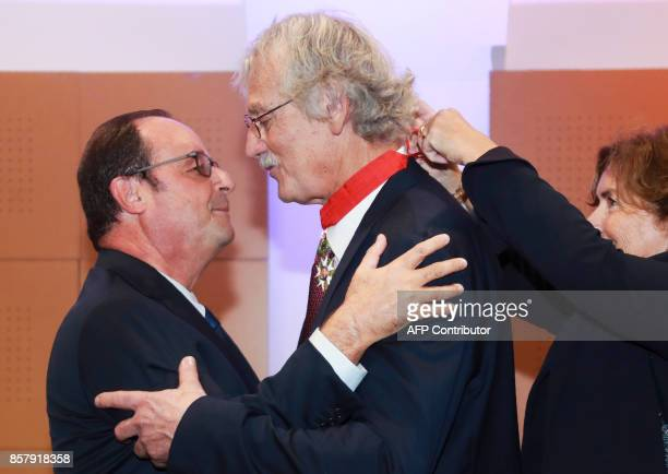 Former French President François Hollande embraces former French judoka, 1975 judo world champion, and current president of the French Judo...