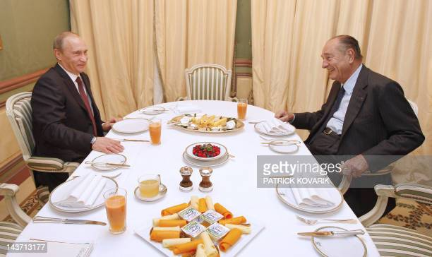 Former French President Jacques Chirac has a breakfast with Russian Prime Minister Vladimir Putin in a Paris hotel, on November 27 as part of the...