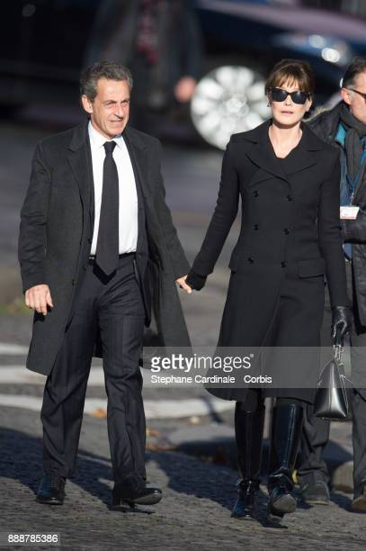 Former French President Nicolas Sarkozy and Carla Bruni Sarkozy arrive at Johnny Hallyday's Funeral Procession at Eglise De La Madeleine on December...