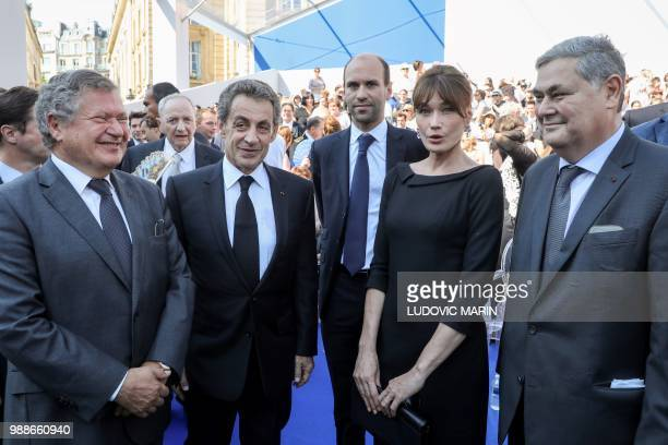 Former French President Nicolas Sarkozy and his wife Carla Bruni talk with the sons of late French politician and Holocaust survivor Simone Veil Jean...