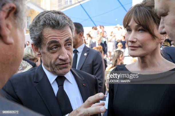 Former French President Nicolas Sarkozy and his wife Carla Bruni arrive to attend the burial ceremony for former French politician and Holocaust...