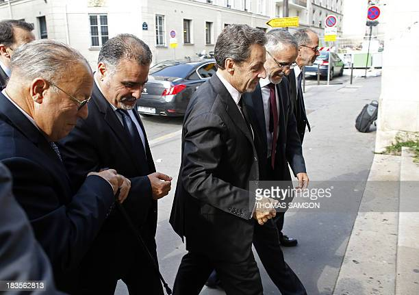 Former French President Nicolas Sarkozy arrives on October 7 2013 at Paris' Great Mosque with the Head of France's Muslim Council and rector the...