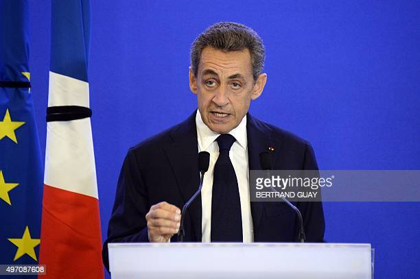 Former French President Nicolas Sarkozy deliver an address at the headquarters of the Les Republicains party in Paris on November 14, 2015 following...