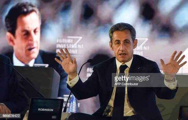 Former French president Nicolas Sarkozy delivers a speech during the Future Investment Initiative conference held in the Saudi capital Riyadh on...