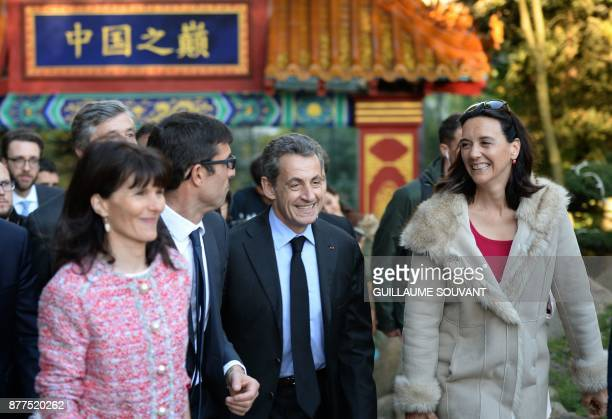 Former French President Nicolas Sarkozy flanked by director of the Beauval zoo Rodolphe Delord and directrice of communication Delphine Delord...