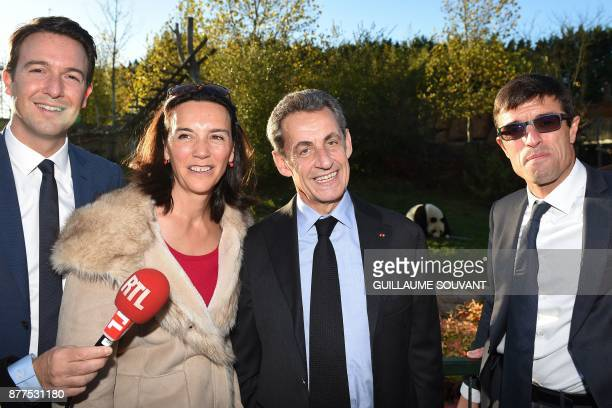 Former French President Nicolas Sarkozy flanked by director of the Beauval zoo Rodolphe Delord directrice of communication Delphine Delord and French...