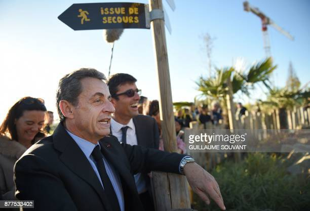 Former French President Nicolas Sarkozy flanked by director of the Beauval zoo Rodolphe Delord and directrice of communication Delphine Delord looks...