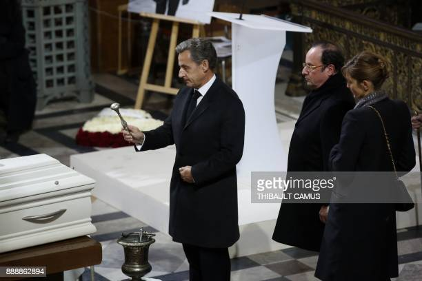 Former French president Nicolas Sarkozy former French president Francois Hollande and French actress Julie Gayet stand next to the coffin during the...