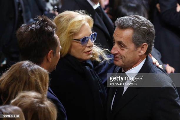 Former French President Nicolas Sarkozy gives condolences to Johnny Hallyday's first wife singer Sylvie Vartan and her son David Hallyday during the...