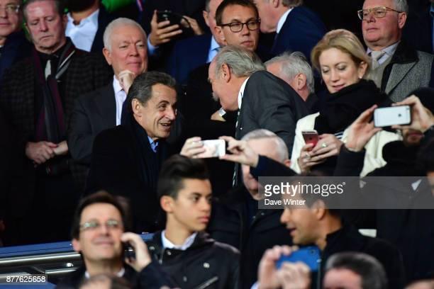 Former French president Nicolas Sarkozy greets Celtic majority shareholder Dermot Desmond during the UEFA Champions League match between Paris Saint...