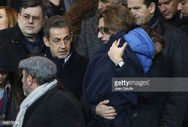Former French President Nicolas Sarkozy his son Jean Sarkozy holding his son Solal Sarkozy attend the French Ligue 1 match between Paris SaintGermain...