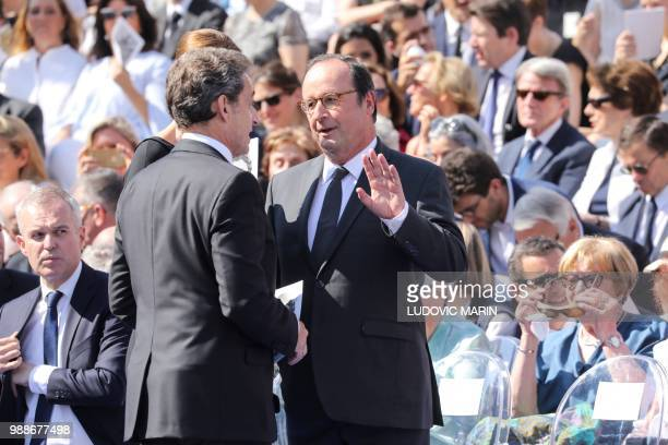 Former French President Nicolas Sarkozy his wife FrenchItalian musician Carla Bruni and former French President Francois Hollande talk as they arrive...