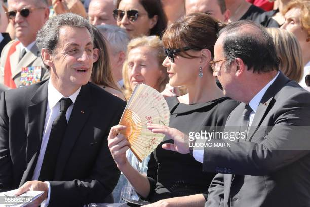 Former French President Nicolas Sarkozy his wife musician Carla Bruni and former French President Francois Hollande attend the burial ceremony for...