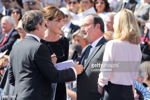 Former French President Nicolas Sarkozy his wife musician Carla Bruni former French President Francois Hollande and his partner French actress Julie...