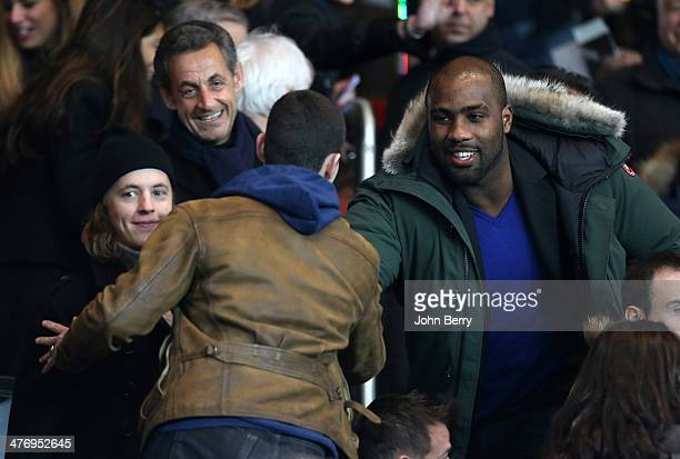 Former French President Nicolas Sarkozy introduces olympic champion in judo Teddy Riner to his sons Pierre Sarkozy and Louis Sarkozy during the Ligue...