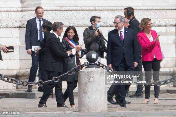 Former French President Nicolas Sarkozy Paris Mayor Anne Hidalgo and President of the French National Assembly Richard Ferrand during a ceremony to...