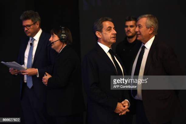 Former French president Nicolas Sarkozy talks to Richard Attias during the Future Investment Initiative conference held in the Saudi capital Riyadh...