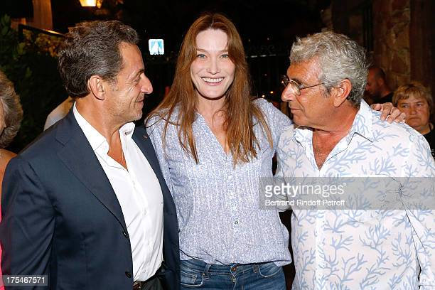 Former French President Nicolas Sarkozy with his wife singer Carla Bruni and Artistic Director of the Festival Michel Boujenah attend 'Pianistic'...