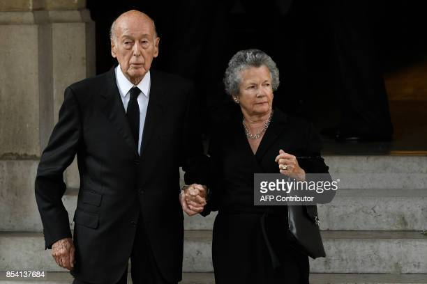 Former French President Valery Giscard d'Estaing and his wife Anne-Aymone leave after attending the funeral of L'Oreal heiress, Liliane Bettencourt,...