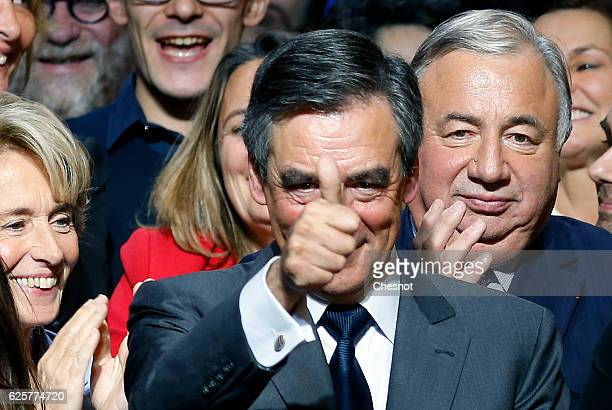 Former French Prime Minister and candidate for the rightwing party 'Les Republicains' Francois Fillon gestures at the end of his meeting on November...