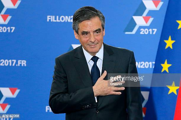 Former French Prime Minister and candidate for the rightwing party 'Les Republicains' Francois Fillon gestures toward the audience after his victory...
