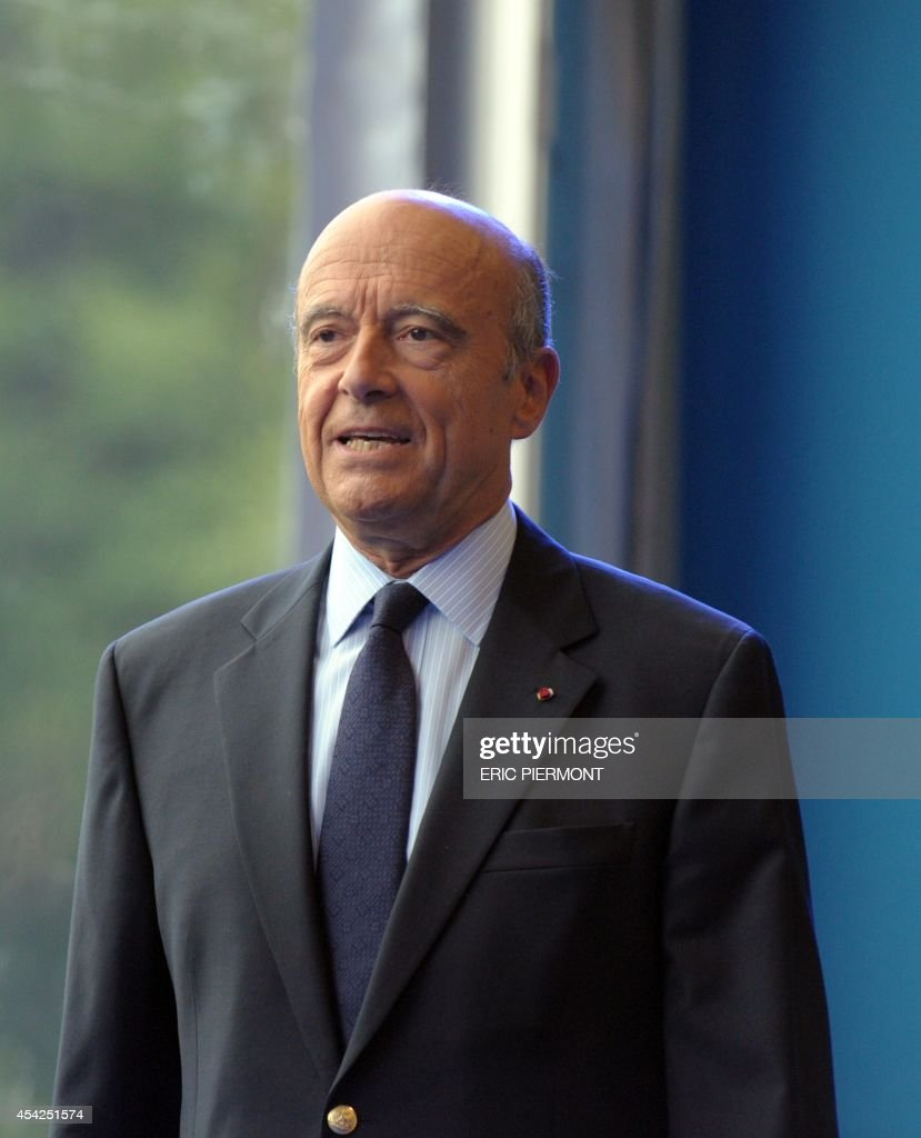 Former French Prime Minister and current mayor of Bordeaux Alain Juppe arrives at the French employers' association Medef summer conference on August 27, 2014 in Jouy-en-Josas, near Paris.