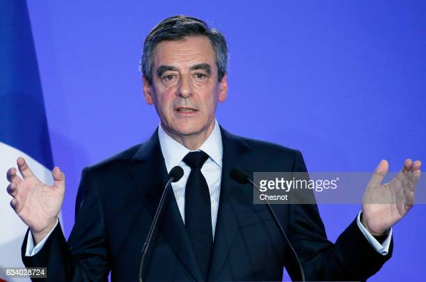 Former French prime minister and French presidential election candidate for the rightwing Les Republicains party Francois Fillon speaks to the media...