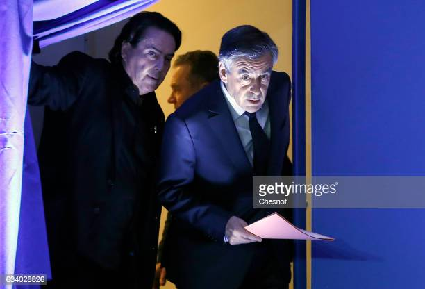 Former French prime minister and French presidential election candidate for the rightwing Les Republicains party Francois Fillon arrive to speak to...