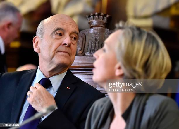 Former French prime minister and Mayor of Bordeaux Alain Juppe and first deputy mayor Virginie Calmels look on during an extraordinary session of the...
