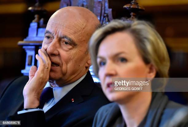 Former French prime minister and Mayor of Bordeaux Alain Juppe speaks with first deputy mayor Virginie Calmels during an extraordinary session of the...