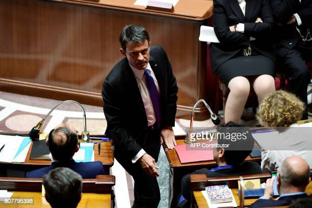 Former French prime minister and Member of Parliament Manuel Valls walks to his seat within the address of the French Prime Minister's general policy...
