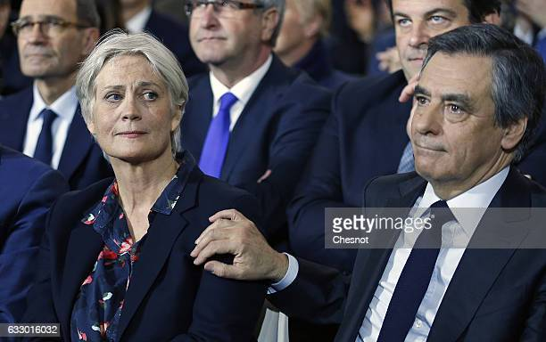 Former French prime minister and member of rightwing political party 'Les Republicains' Francois Fillon reacts as he touches his wife Penelope Fillon...