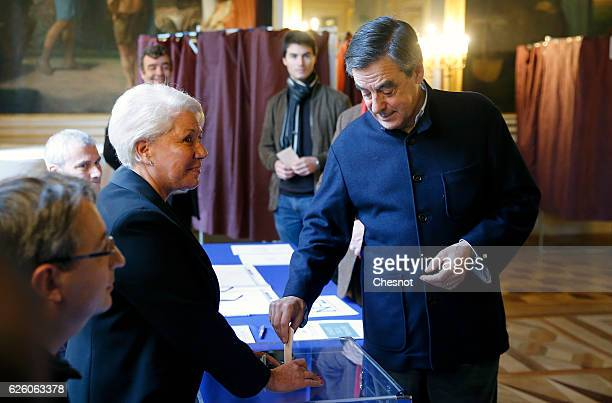 Former French Prime Minister and presidential candidate hopeful Francois Fillon votes during the second round of voting in the Republican Party's...